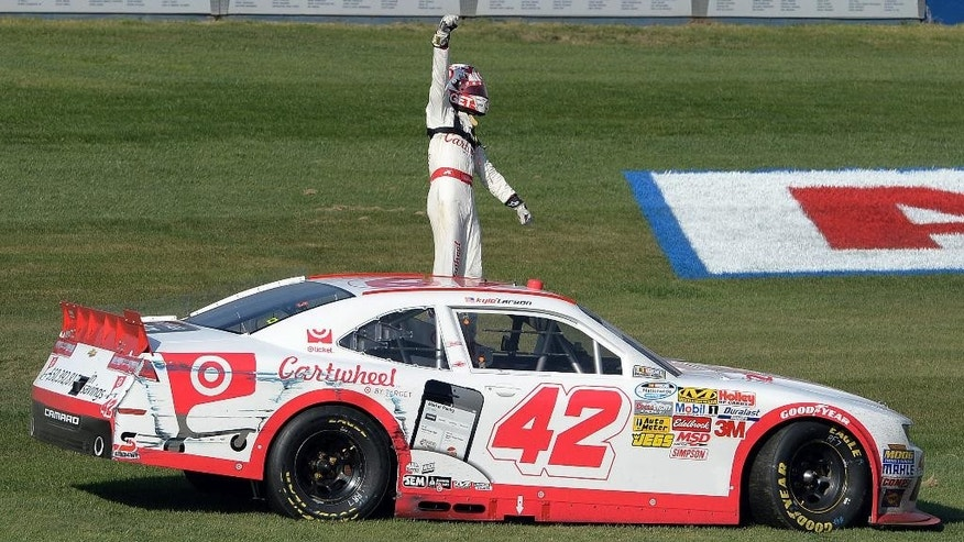 Kyle Larson (42) stands on his car following his first career win in a NASCAR Nationwide Series auto race, in Fontana, Calif., Saturday March 22, 2014. (AP Photo/The Inland Valley Daily Bulletin, Will Lester) LA TIMES, VENTURA COUNTY STAR & RIVERSIDE PRESS-ENTERPRISE  OUT  TV OUT  MAGS OUT