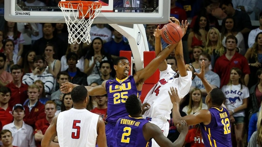 LSU forward Jordan Mickey (25) and SMU forward Ben Moore (34) fight for a rebound during the first half of an NCAA college basketball game in the second round of the NIT Monday, March 24, 2014, in Dallas, Texas. (AP Photo/Sharon Ellman)