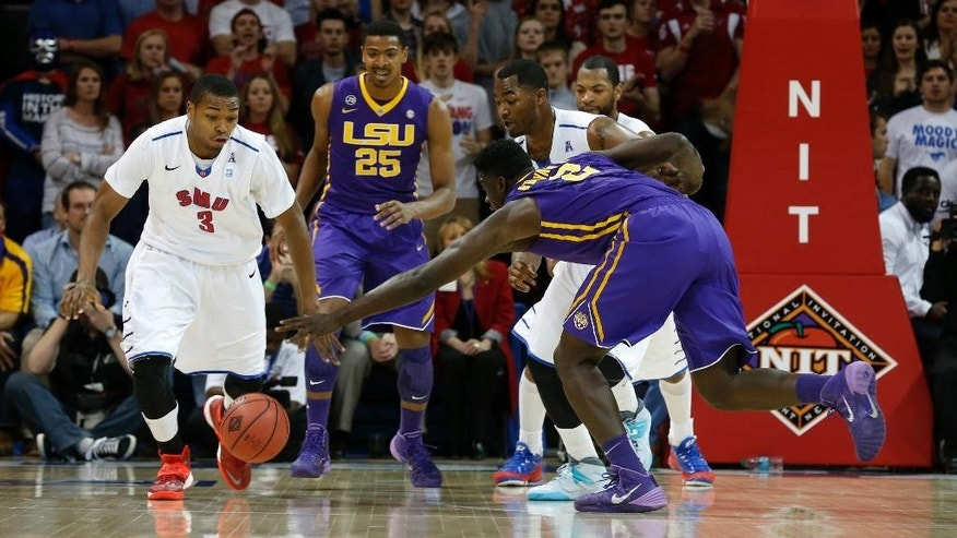 SMU guard Sterling Brown (3) and LSU forward Johnny O'Bryant III (2) scrambles for a loose ball during the first half of an NCAA college basketball game in the second round of the NIT Monday, March 24, 2014, in Dallas, Texas. (AP Photo/Sharon Ellman)