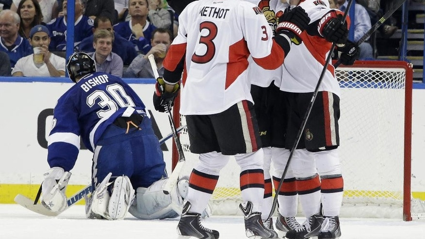 Ottawa Senators center Kyle Turris (7), right, celebrates with teammates right wing Mark Stone (61) and defenseman Marc Methot (3) after scoring past Tampa Bay Lightning goalie Ben Bishop (30) during the second period of an NHL hockey game Monday, March 24, 2014, in Tampa, Fla. (AP Photo/Chris O'Meara)
