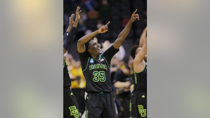 Baylor's Taurean Prince (35) celebrates with teammate after they they defeated Creighton in a third-round game in the NCAA college basketball tournament Sunday, March 23, 2014, in San Antonio. Baylor won 85-55. (AP Photo/Eric Gay)
