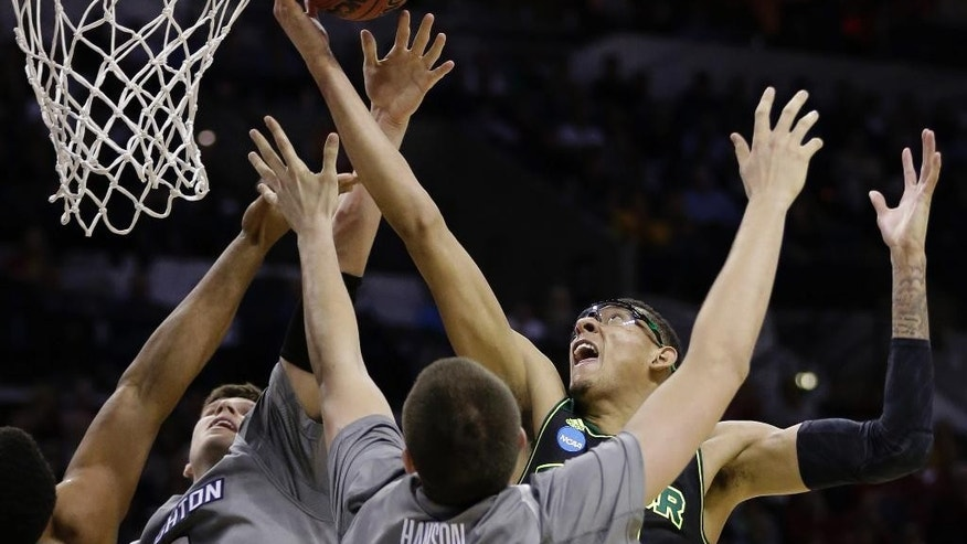 Baylor's Isaiah Austin, right, reaches over Creighton's Doug McDermott (3) and Zach Hanson (40) for a rebound during the first half of a third-round game in the NCAA college basketball tournament Sunday, March 23, 2014, in San Antonio. (AP Photo/Eric Gay)
