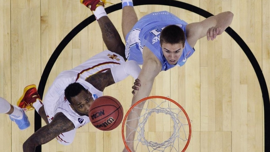 Iowa State's DeAndre Kane, left, makes the winning shot over North Carolina's Jackson Simmons, right, in the final seconds of the second half of a third-round game in the NCAA college basketball tournament Sunday, March 23, 2014, in San Antonio. Iowa State won 85-83. (AP Photo/Eric Gay)