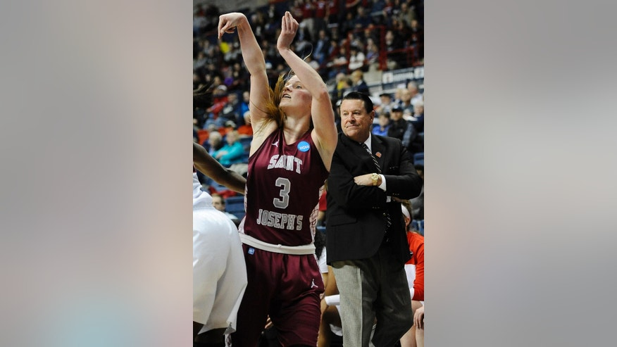 Saint Joseph's Erin Shields makes a three-point shot as Georgia head coach Andy Landers, right, looks on, during the first half of a first-round game of the NCAA women's college basketball tournament, Sunday, March 23, 2014, in Storrs, Conn. (AP Photo/Jessica Hill)