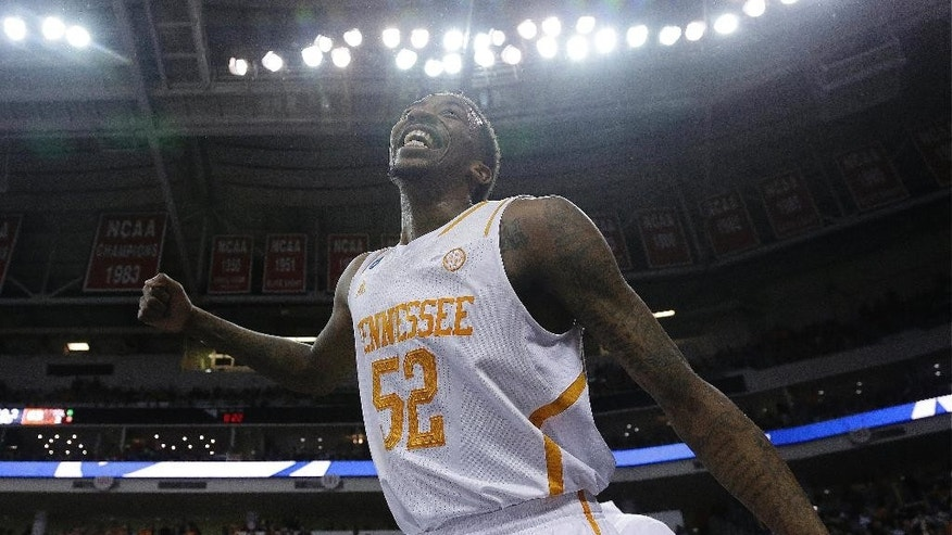 Tennessee guard Jordan McRae (52) celebrates after the second half of an NCAA college basketball third-round tournament game against  Mercer , Sunday, March 23, 2014, in Raleigh. Tennessee won 83-73. (AP Photo/Gerry Broome)