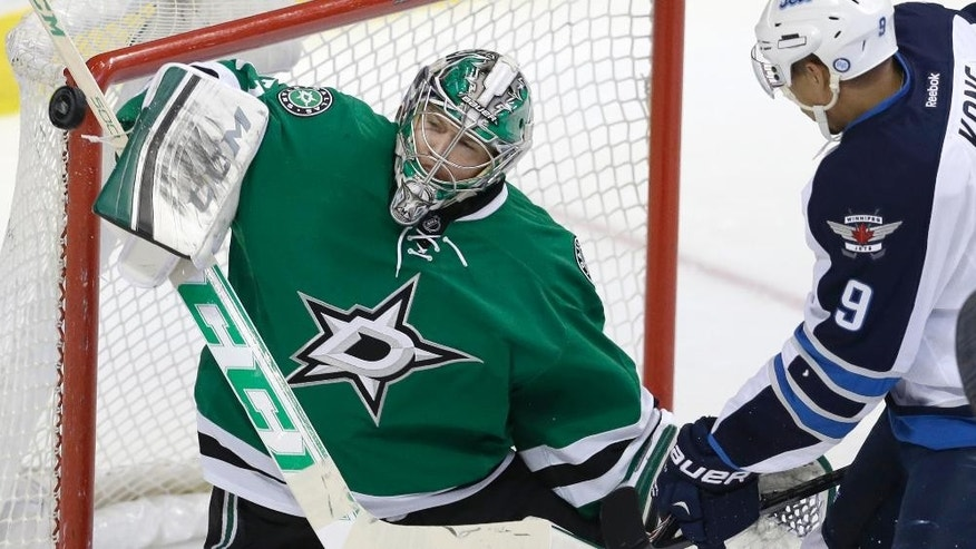 Dallas Stars goalie Kari Lehtonen (32) blocks a shot against Winnipeg Jets left wing Evander Kane (9) during the second period of an NHL hockey game Monday, March 24, 2014, in Dallas. (AP Photo/LM Otero)