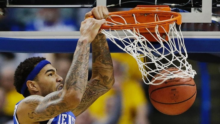 Kentucky forward Willie Cauley-Stein (15) dunks against Wichita State during the second half of a third-round game of the NCAA college basketball tournament Sunday, March 23, 2014, in St. Louis. (AP Photo/Jeff Roberson)
