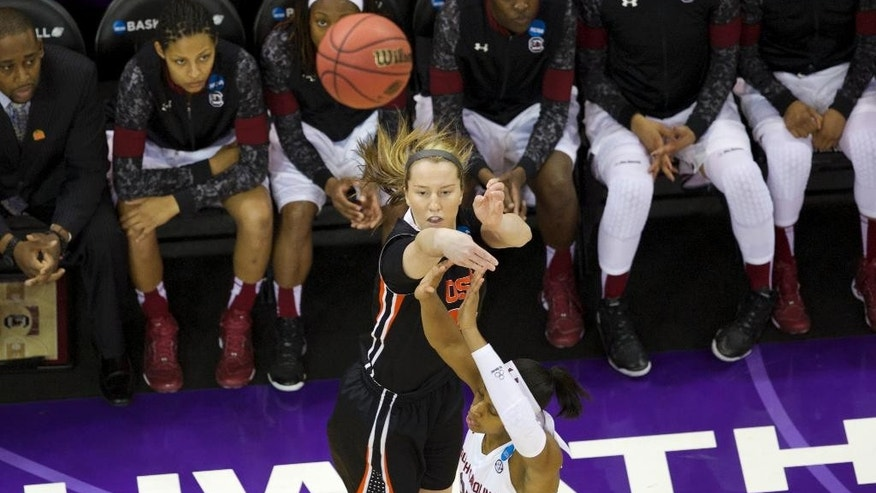 Oregon State guard Ali Gibson shoots over South Carolina guard Tiffany Mitchell (25) during the first half of a second-round game of the NCAA women's college basketball tournament, Tuesday, March 25, 2014, in Seattle. (AP Photo/The Oregonian, Randy L Rasmussen) MAGS OUT, TV OUT, LOCAL TV AND INTERNET OUT, (THE MERCURY, WILLAMETTE WEEK, PAMPLIN MEDIA GROUP OUT)