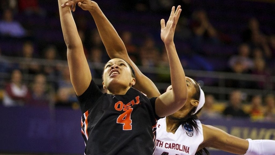 Oregon State's Breanna Brown (4) is fouled by South Carolina's Alaina Coates (41 during the first half of a second-round game of the NCAA women's college basketball tournament, Tuesday, March 25, 2014, in Seattle. (AP Photo/The Oregonian, Randy L Rasmussen) MAGS OUT, TV OUT, LOCAL TV AND INTERNET OUT, (THE MERCURY, WILLAMETTE WEEK, PAMPLIN MEDIA GROUP OUT)