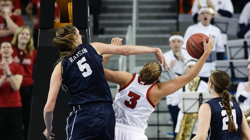 Nebraska's Hailie Sample (3) gets her shot blocked by BYU's Jennifer Hamson (5) during the first half of a second-round game in the NCAA women's college basketball tournament on Monday, March 24, 2014, in Los Angeles. (AP Photo/Jae C. Hong)