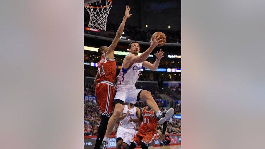 Los Angeles Clippers forward Hedo Turkoglu, right, of Turkey, puts up a shot as Milwaukee Bucks guard Giannis Antetokounmpo, of Greece, defends during the first half of an NBA basketball game, Monday, March 24, 2014, in Los Angeles.  (AP Photo/Mark J. Terrill)