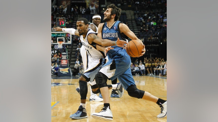 Minnesota Timberwolves guard Ricky Rubio, right, of Spain, gets fouled by Memphis Grizzlies guard Mike Conley (11) in the first half of an NBA basketball game Monday, March 24, 2014, in Memphis, Tenn. (AP Photo/Lance Murphey)