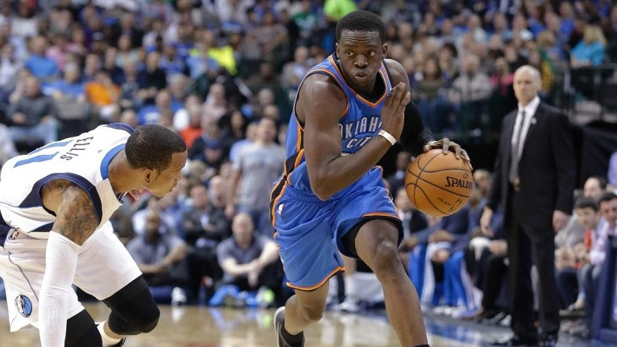 Oklahoma City Thunder guard Reggie Jackson, right, drives against Dallas Mavericks guard Monta Ellis during the first half of an NBA basketball game Tuesday, March 25, 2014, in Dallas. (AP Photo/LM Otero)