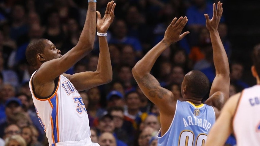 Oklahoma City Thunder forward Kevin Durant (35) shoots over Denver Nuggets forward Darrell Arthur (00) in the first quarter of an NBA basketball game in Oklahoma City, Monday, March 24, 2014. (AP Photo/Sue Ogrocki)