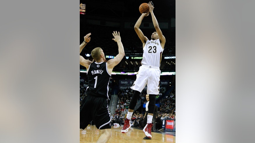 New Orleans Pelicans forward Anthony Davis (23) shoots the ball over Brooklyn Nets forward Mason Plumlee (1) during the second half of an NBA basketball game in New Orleans, Monday, March 24, 2014. The Pelicans won 109-104. (AP Photo/Jonathan Bachman)