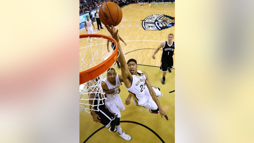 New Orleans Pelicans forward Anthony Davis (23) shoots the ball during the first half of an NBA basketball game against the Brooklyn Nets in New Orleans, Monday, March 24, 2014. (AP Photo/Jonathan Bachman)