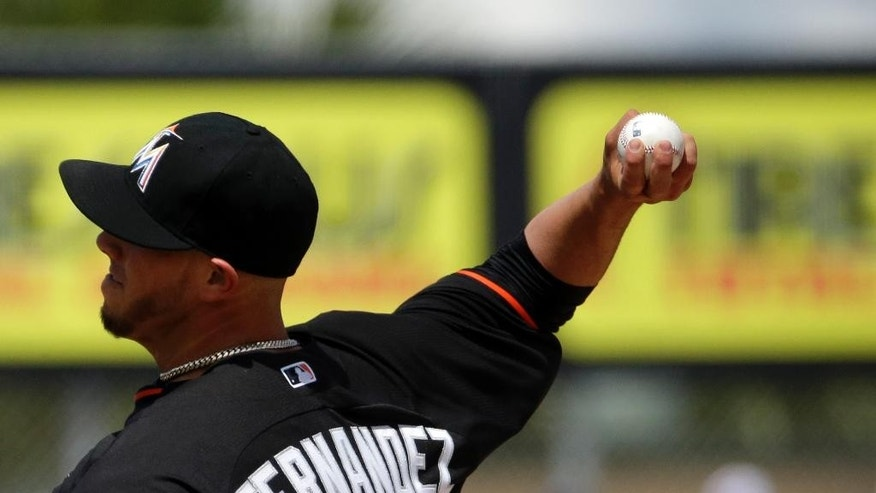 Miami Marlins starting pitcher Jose Fernandez throws in the first inning of an exhibition spring training baseball game against the St. Louis Cardinals, Tuesday, March 25, 2014, in Jupiter, Fla. (AP Photo/David Goldman)