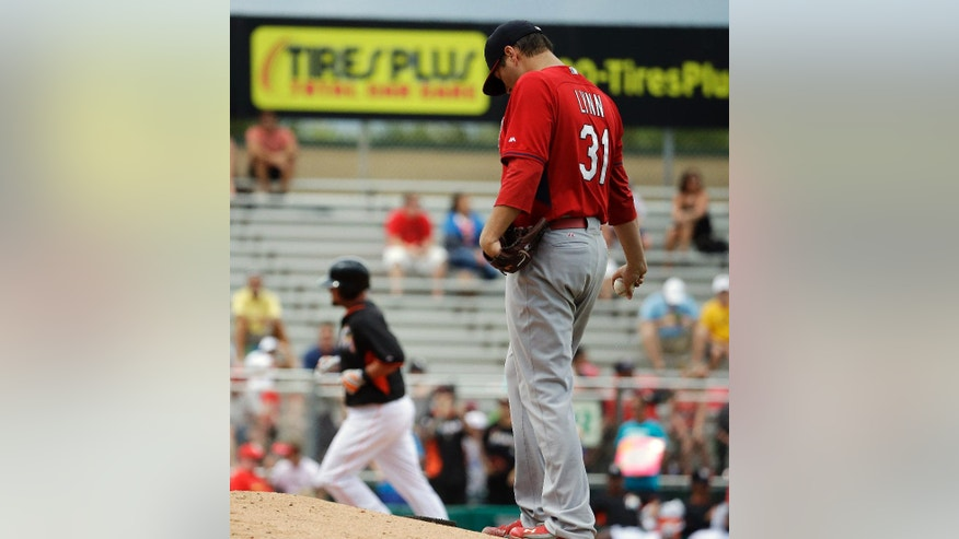 St. Louis Cardinals starting pitcher Lance Lynn, right, stands on the mound after giving up a home run to Miami Marlins' Casey McGehee, left, in the fourth inning of an exhibition spring training baseball game, Tuesday, March 25, 2014, in Jupiter, Fla. (AP Photo/David Goldman)