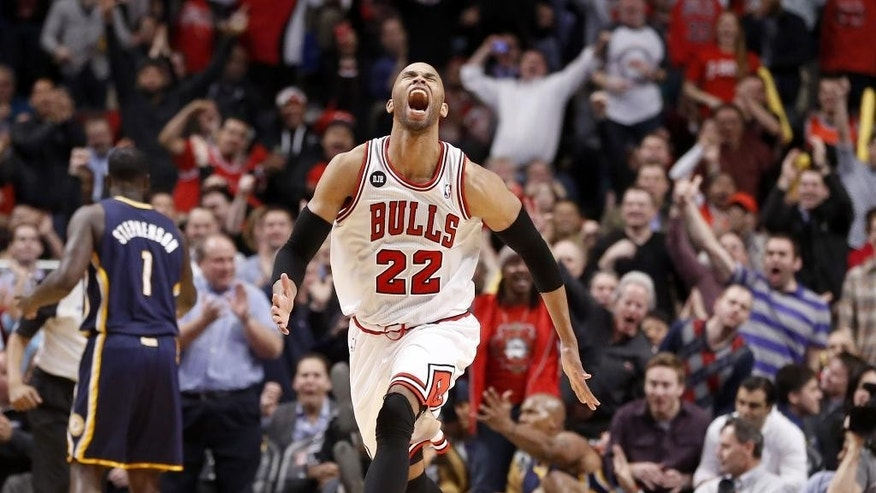 Chicago Bulls forward Taj Gibson (22) celebrates after his dunk off a rebound during the second half of an NBA basketball game against the Indiana Pacers Monday, March 24, 2014, in Chicago. The Bulls won 89-77. (AP Photo/Charles Rex Arbogast)