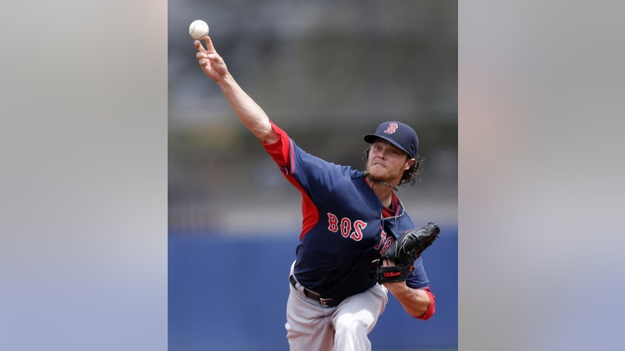 Boston Red Sox starting pitcher Clay Buchholz pitches in the first inning of an exhibition baseball game against the Tampa Bay Rays in Port Charlotte, Fla., Tuesday, March 25, 2014. (AP Photo/Gerald Herbert)