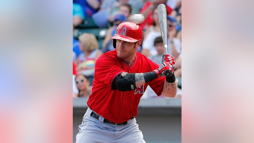 Los Angeles Angels' Josh Hamilton takes a high fastball against the Chicago Cubs' during the first inning of a spring training baseball game, Tuesday, March 25, 2014, in Mesa, Ariz. (AP Photo/Matt York)