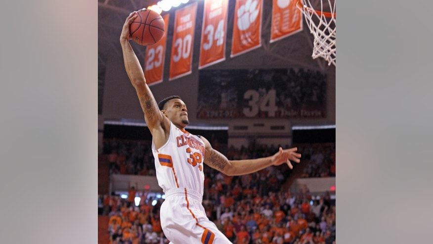 Clemson's K.J. McDaniels prepares to dunk during the first half of their NCAA college basketball National Invitational Tournament game against Belmont at Littlejohn Coliseum in Clemson, S.C., on Tuesday, Mar. 25, 2014. (AP Photo/Anderson Independent-Mail, Mark Crammer)