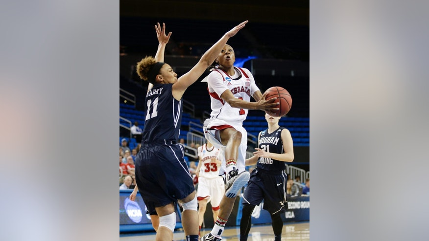 Nebraska's Tear'a Laudermill (1) goes up for a basket as she is defended by BYU's Xojian Harry (11) during the second half of a second-round game in the NCAA women's college basketball tournament on Monday, March 24, 2014, in Los Angeles. BYU won 80-76. (AP Photo/Jae C. Hong)