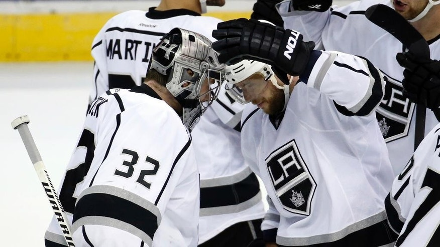 Los Angeles Kings goalie Jonathan Quick (32) celebrates with right wing Marian Gaborik (12), from the Czech Republic, after an NHL hockey game against the Washington Capitals, Tuesday, March 25, 2014, in Washington. The Kings won 5-4 in a shootout. (AP Photo/Alex Brandon)