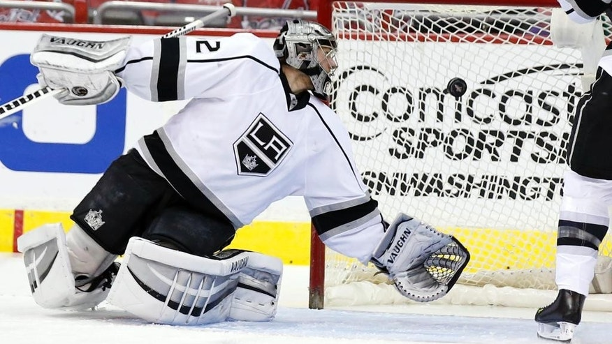 Los Angeles Kings goalie Jonathan Quick can't stop a goal by Washington Capitals right wing Alex Ovechkin, from Russia, in the first period of an NHL hockey game, Tuesday, March 25, 2014, in Washington. (AP Photo/Alex Brandon)