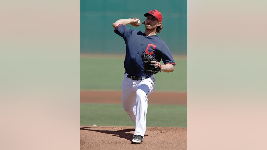 Cleveland Indians' Josh Tomlin throws before a spring exhibition baseball game against the Texas Rangers Tuesday, March 25, 2014, in Goodyear, Ariz. (AP Photo/Darron Cummings)