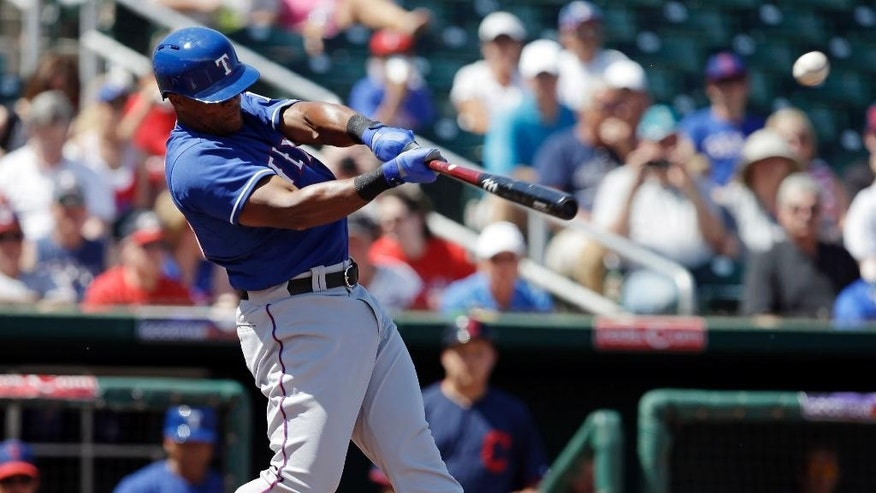 Texas Rangers' Adrian Beltre hits a two-run RBI single during the first inning of a spring exhibition baseball game against the Cleveland Indians, Tuesday, March 25, 2014, in Goodyear, Ariz. (AP Photo/Darron Cummings)