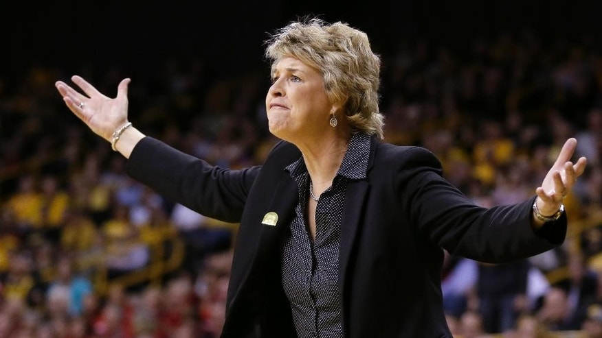 Iowa head coach Lisa Bluder reacts to a call during the first half of an NCAA tournament second-round women's college basketball game against Louisville, Tuesday, March 25, 2014, in Iowa City, Iowa. (AP Photo/Charlie Neibergall)