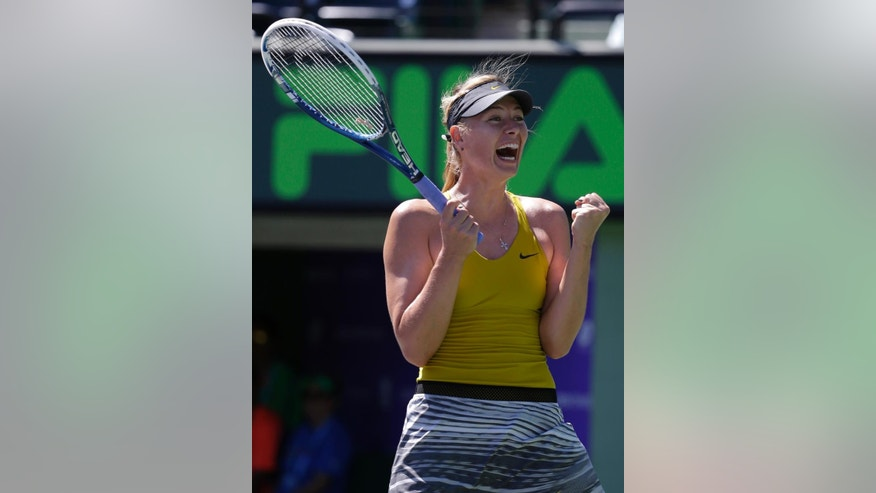 Maria Sharapova, of Russia, reacts after defeating Petra Kvitova, 7-5, 6-1 at the Sony Open Tennis tournament, Tuesday, March 25, 2014, in Key Biscayne, Fla. (AP Photo/Lynne Sladky)