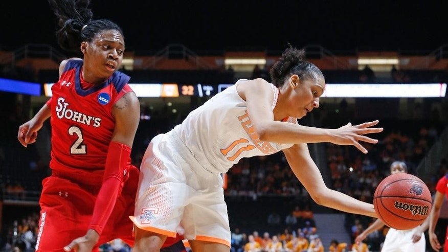 Tennessee forward Cierra Burdick (11) grabs a rebound in front of St. John's forward Amber Thompson (2) in the first half of an NCAA women's college basketball second-round tournament game Monday, March 24, 2014, in Knoxville, Tenn. (AP Photo/John Bazemore)