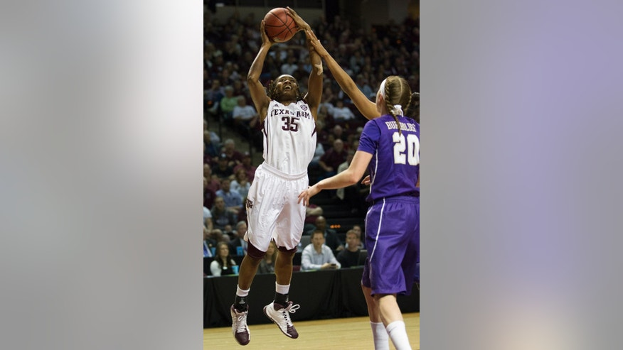 Texas A&M forward Achiri Ade (35) takes a shot during the first half of an NCAA women's basketball game against James Madison, Tuesday, March 25, 2014, in College Station, Texas. (AP Photo/Patric Schneider)