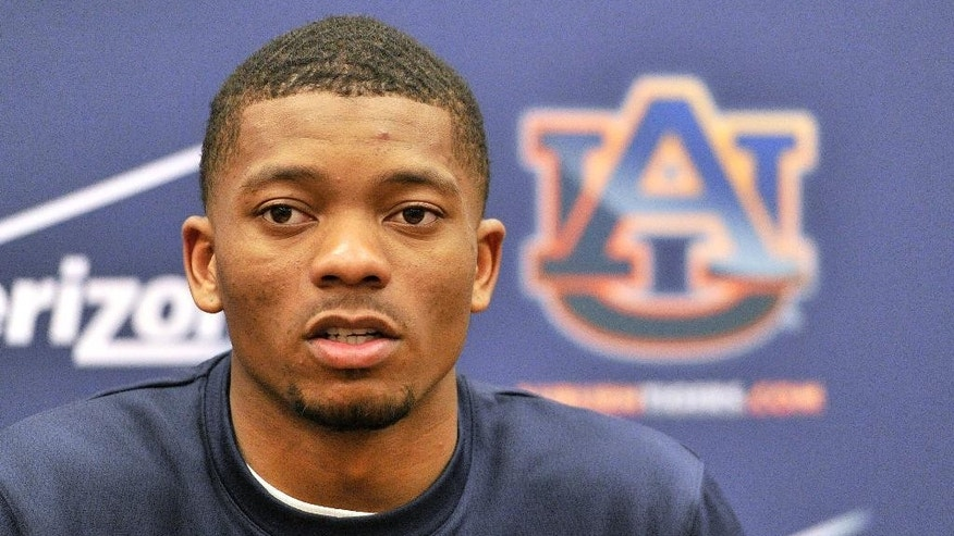Auburn quarterback Nick Marshall (14) talks to the media  NCAA college football practice at the Auburn Athletic Complex Saturday, March 22, 2014, in Auburn, Ala. (AP Photo/AL.com, Julie Bennett) MAGS OUT