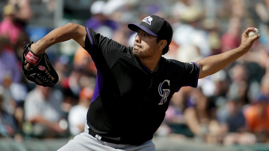 Colorado Rockies starting pitcher Jorge De La Rosa throws to the San Francisco Giants during the second inning of an exhibition baseball game in Scottsdale, Ariz., Wednesday, March 26, 2014. (AP Photo/Chris Carlson)