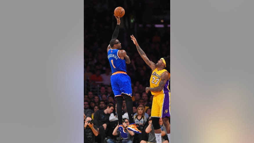 New York Knicks forward Amar'e Stoudemire, left, puts up a shot as Los Angeles Lakers forward Jordan Hill defends during the first half of an NBA basketball game, Tuesday, March 25, 2014, in Los Angeles. (AP Photo/Mark J. Terrill)