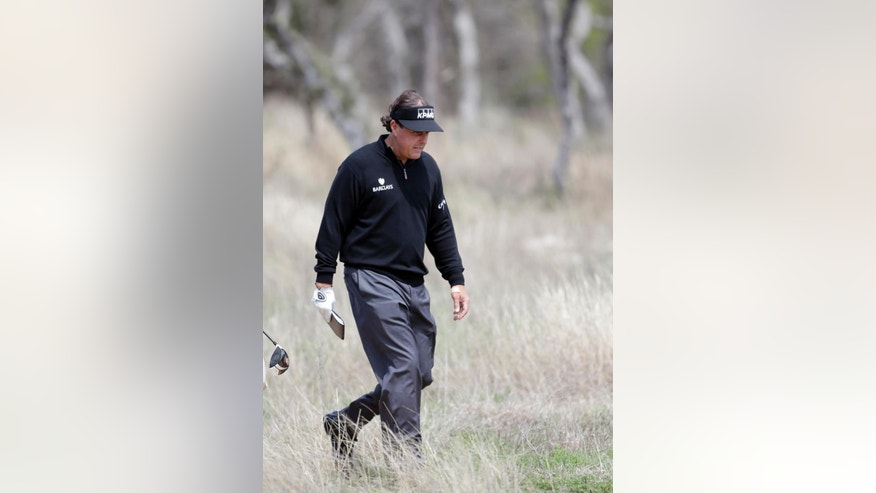 Phil Mickelson takes part in a pro-am at the Valero Texas Open, Wednesday, March 26, 2014, in San Antonio. Mickelson is straying from his usual schedule and playing in the Valero Texas Open for the first time in 22 years. (AP Photo/Eric Gay)