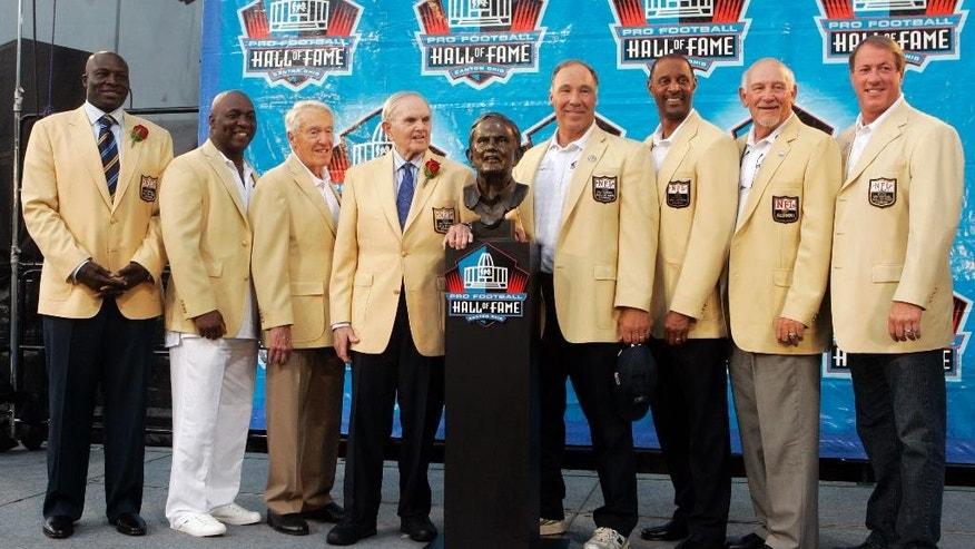 FILE - In this Aug. 8, 2009, file photo, Ralph Wilson Jr., fourth from left, owner of the Buffalo Bills, poses with his bust and former Buffalo Bills players, from left, Bruce Smith, Thurman Thomas, Marv Levy, Joe DeLamielleure, James Lofton, Billy Shaw and Jim Kelly during the Pro Football Hall of Fame induction ceremony at the Pro Football Hall of Fame in Canton, Ohio. Bills owner Wilson Jr. has died at the age of 95 at his home in Grosse Pointe Shores, Mich. NFL.com says team president Russ Brandon announced his death at the league's annual meeting in Orlando, Fla., Tuesday, March 25, 2014. He was one of the original founders of the American Football League and owned the Bills for the last 54 years. (AP Photo/Tony Dejak, File)