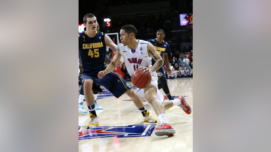 California forward David Kravish (45) defends as SMU guard Nic Moore (11) drives to the basket during the first half of an NCAA college basketball game in the quarterfinals of the NIT, Wednesday, March 26, 2014, in Dallas. (AP Photo/Sharon Ellman)