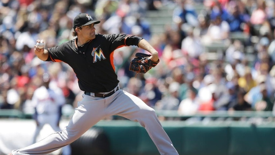 Miami Marlins starting pitcher Nathan Eovaldi throws during the first inning of an exhibition baseball game against the Atlanta Braves in Kissimmee, Fla., Wednesday, March 26, 2014. (AP Photo/Carlos Osorio)