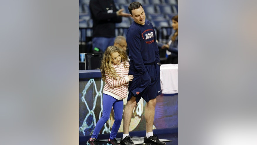 Dayton head coach Archie Miller watches practice with his daughter Leah Grace at the NCAA college basketball tournament, Wednesday, March 26, 2014, in Memphis, Tenn. Dayton plays Stanford in a regional semifinal on Thursday. (AP Photo/Mark Humphrey)