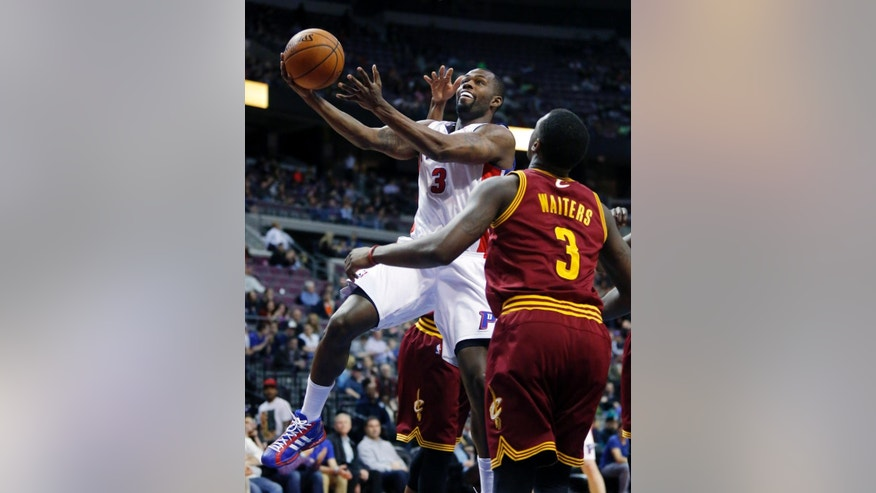 Detroit Pistons guard Rodney Stuckey, left, goes to the basket past Cleveland Cavaliers guard Dion Waiters, right, during the first period of an NBA basketball game Wednesday, March 26, 2014, in Auburn Hills, Mich. (AP Photo/Duane Burleson)