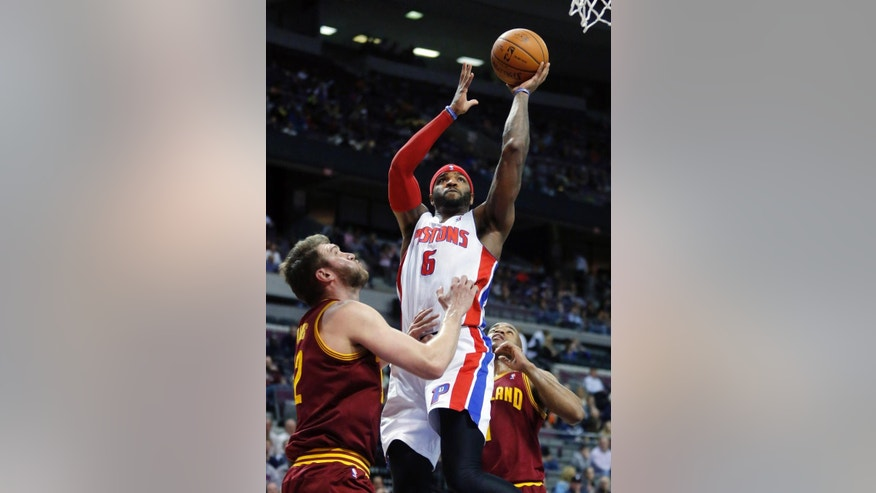 Detroit Pistons forward Josh Smith (6) takes a shot against Cleveland Cavaliers center Spencer Hawes (32) as guard Jarrett Jack, right, helps defend during the first period of an NBA basketball game Wednesday, March 26, 2014, in Auburn Hills, Mich. (AP Photo/Duane Burleson)