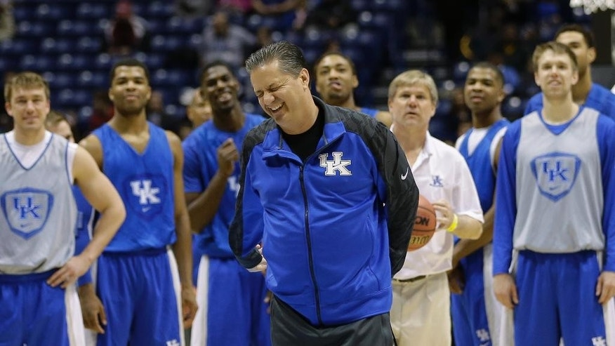 Kentucky head coach John Calipari reacts after missing a half court shot as players watch during practice for their NCAA Midwest Regional semifinal college basketball tournament game Thursday, March 27, 2014, in Indianapolis. Kentucky plays Louisville on Friday, March 28, 2013. (AP Photo/David J. Phillip)