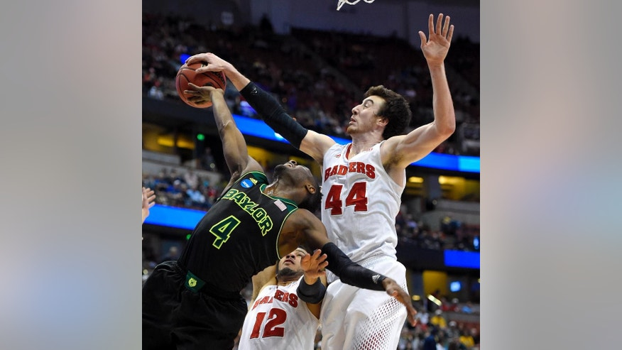 Baylor guard Gary Franklin (4) has a shot stopped by Wisconsin forward Frank Kaminsky (44) during an NCAA men's college basketball tournament regional semifinal, Thursday, March 27, 2014, in Anaheim, Calif. (AP Photo/Mark J. Terrill)