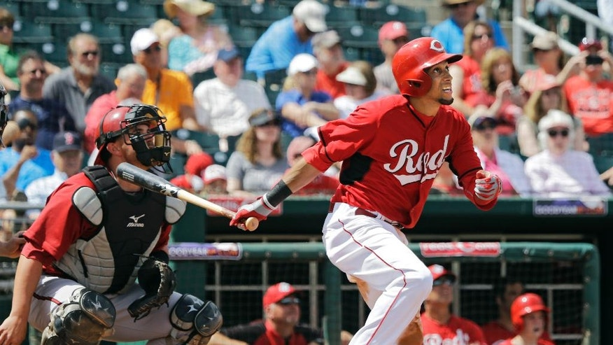 Cincinnati Reds' Billy Hamilton watches his triple with Arizona Diamondbacks catcher Bobby Wilson, left, in the fourth inning of a spring exhibition baseball game Thursday, March 27, 2014, in Goodyear, Ariz. (AP Photo/Mark Duncan)