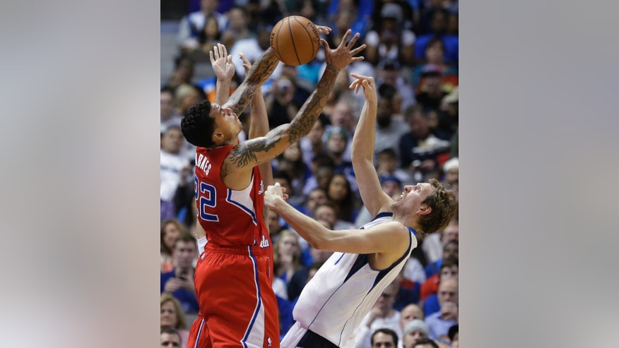 Los Angeles Clippers forward Matt Barnes (22) steals the ball from Dallas Mavericks forward Dirk Nowitzki during the first half of an NBA basketball game Thursday, March 27, 2014, in Dallas. (AP Photo/LM Otero)