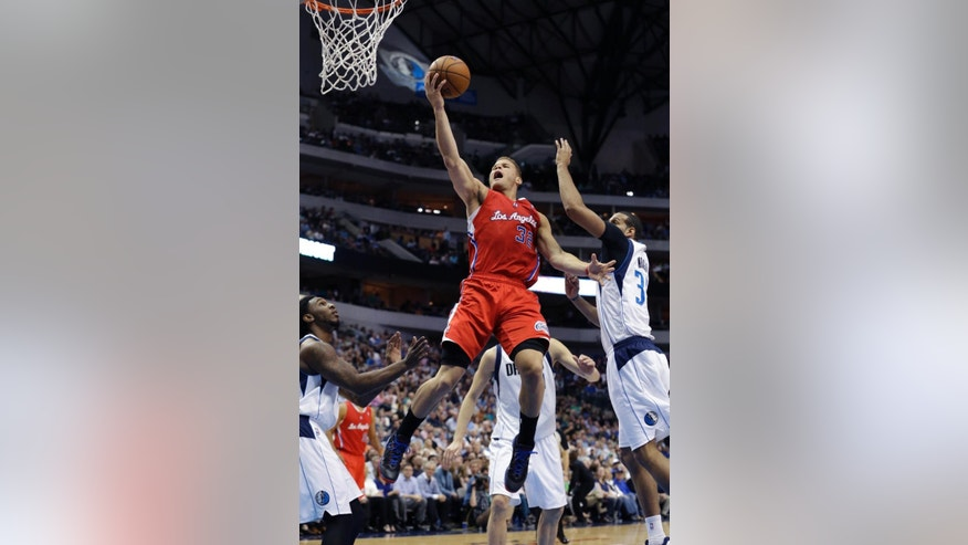 Los Angeles Clippers forward Blake Griffin (32) drives to the basket between Dallas Mavericks defenders Brandan Wright (34) and Jae Crowder during the first half of an NBA basketball game Thursday, March 27, 2014, in Dallas. (AP Photo/LM Otero)